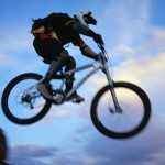 Mountain Biker Jumping Cliff